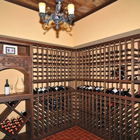 Expansive, dark stained wood wine cellar for Sugarland Lane