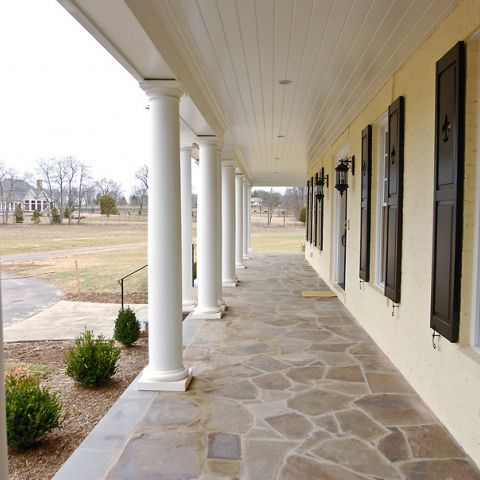 An expansive front porch on Sugarland Lane by Frank M Bell
