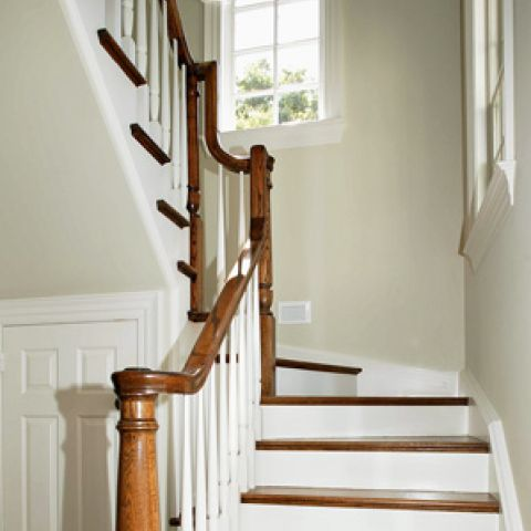 Bright, modern staircase with natural wood highlights