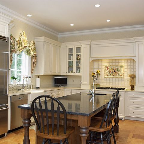 Bright and white farmhouse style kitchen with stainless steel appliances