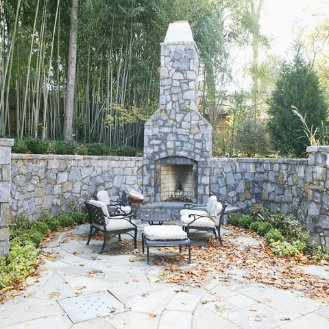 An outdoor stone fireplace for Frank Bell's project on Selkirk Dr.