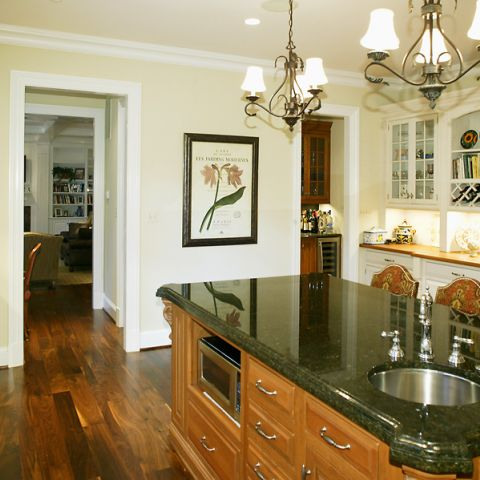 Green and creme kitchen renovation from Ballard & Mensua's project on Selkirk Dr