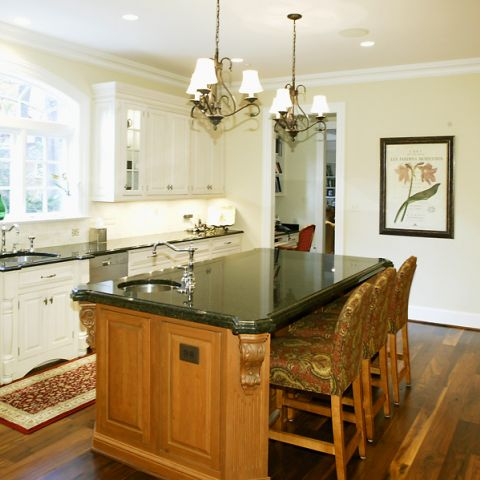 Left angle of Selkirk Drive's new kitchen with kitchen island and pendant lighting