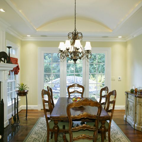 Informal dining room with french doors and dark green accents