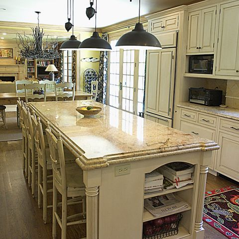 Farmhouse style kitchen with offwhite cabinets and dark accessories
