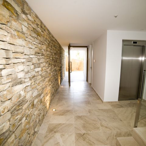 downstairs elevator nook and hallway - Costa Brava Overlook - Ballard & Mensua Architecture