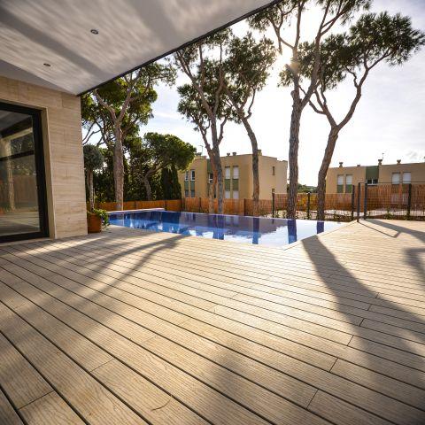 beautiful dark finished deck with backyard pool - Ballard & Mensua