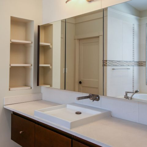 vertical scone in master bath - Modern home makeover - Carr Baron project