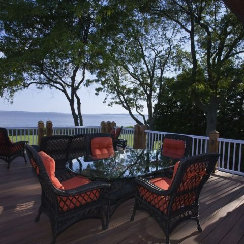 Carr project - nautical New England waterfront home - terrace at sunset