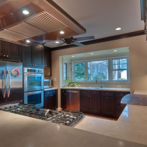 Henry project's kitchen after remodeling with fridge and range