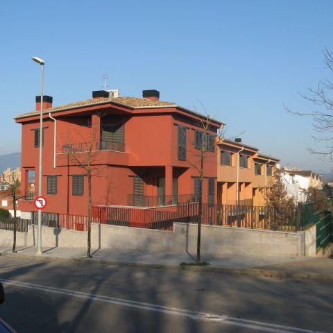 red corner house exterior - urban villa - Ballard & Mensua
