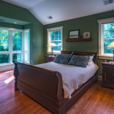 master bedroom with large windows - Two story renovation - Loucks project